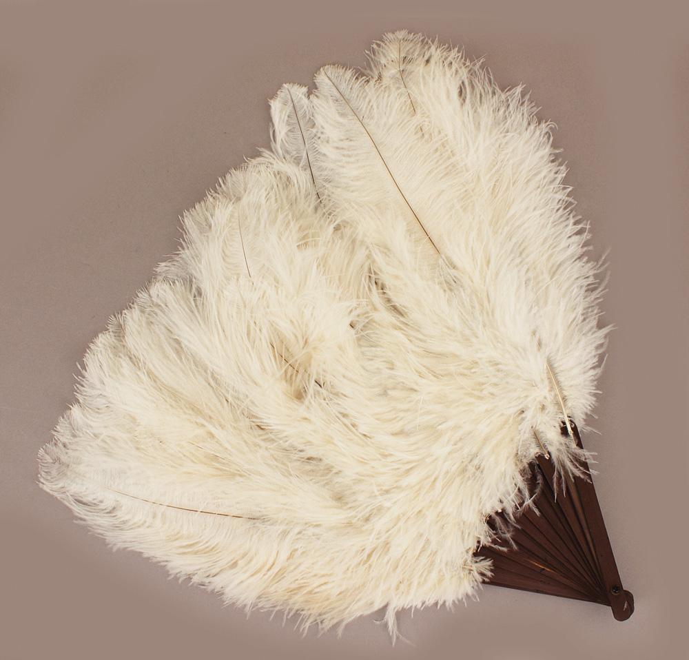 Lot Detail - Christina Aguilera Cream Antique Ostrich